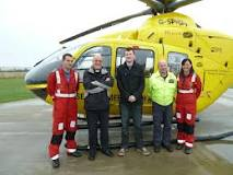 Dorset and Somerset Air Ambulance receive their £750.00 cheque from Moggy